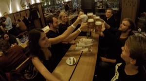 Group of friends grabbing German beer at a Bavarian restaurant in Berlin