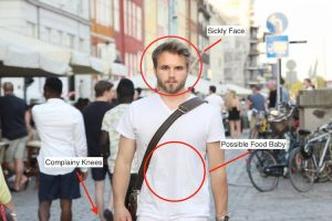 Christian Ostmo Stands in the middle of Copenhagen looking pregnant
