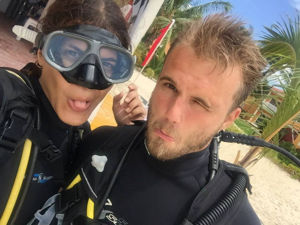 Deborah and Christian Ostmo making fuynny faces in scuba gear